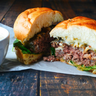 Surf and Turf Burger with Bacon Bourbon Butter and Cajun Aioli